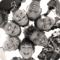 Group of teens looking at camera from above