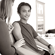 Young male receiving HPV vaccine injection